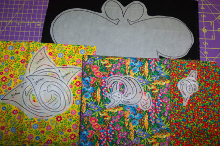 Place each stack on top of the fabric you plan to use for those sections.