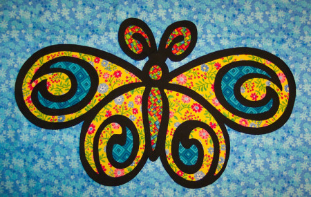 Therefore, the entire butterfly can now be placed on any number of background fabrics until I find just the right one for the look I'm after.